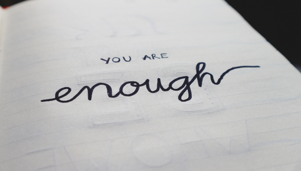 """you are enough"" text linked to Is scarcity mindset stealing your mojo blog post."