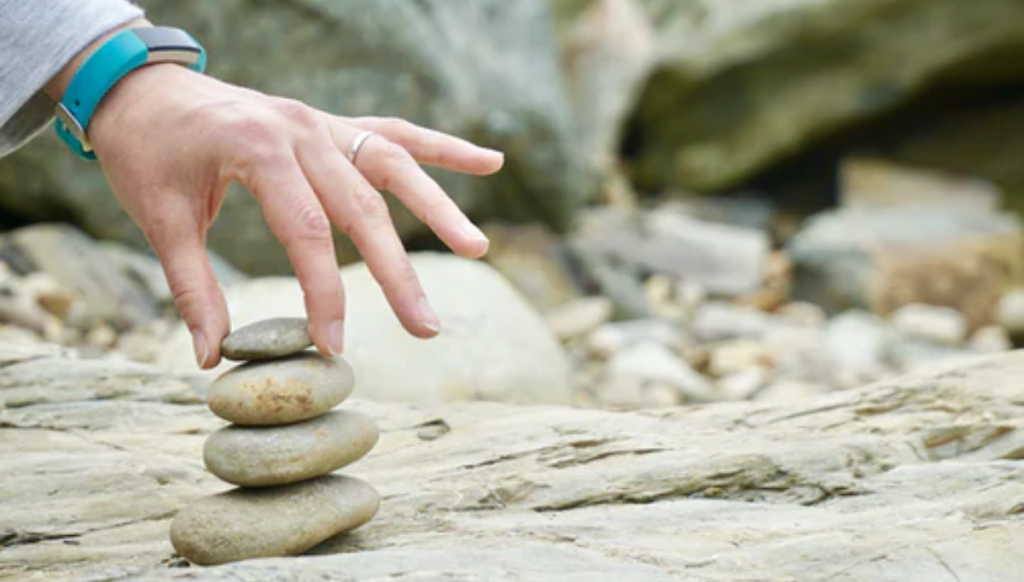 Hand balancing a rocks. Linking to blog post So what's this emotional intelligence stuff and does it make a difference?